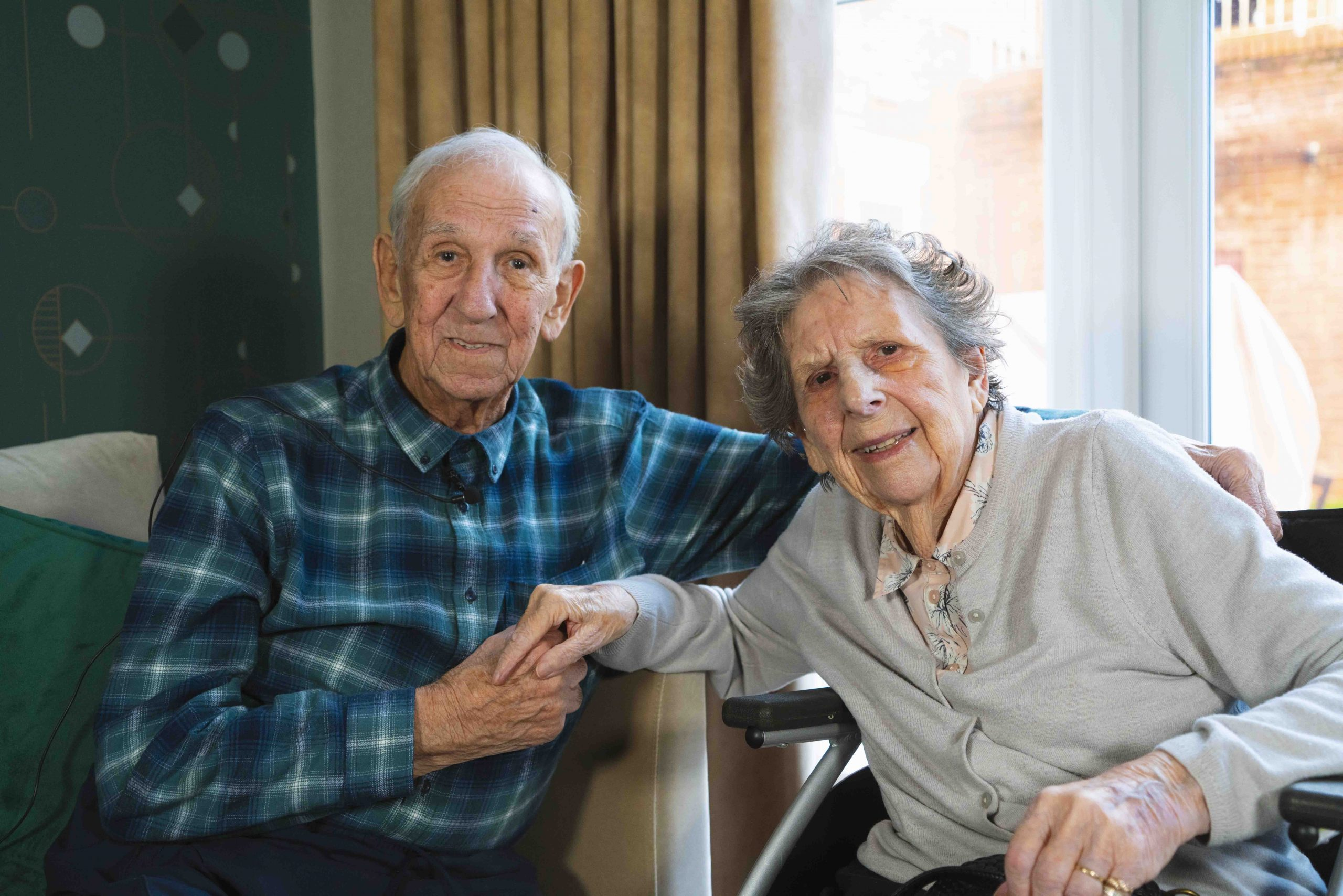 Elderly gentleman and lady; married couple in care home setting.