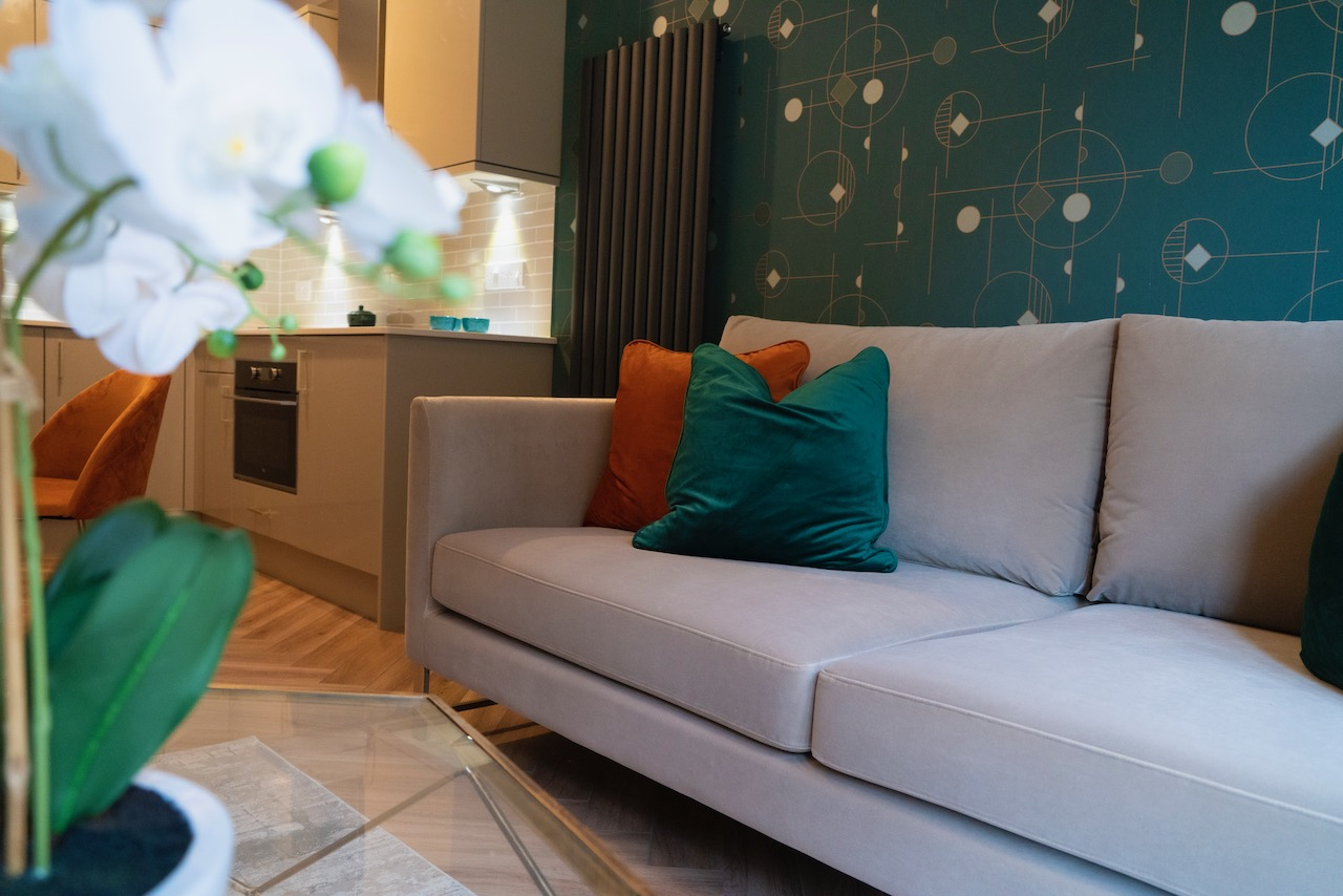 residential suites sofa flower in foreground