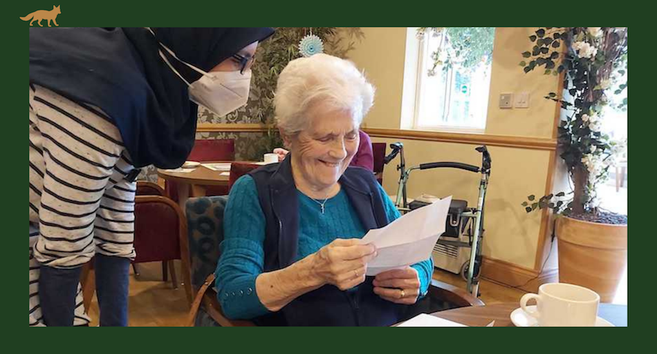 Foxholes resident opening World Kindness Day letters