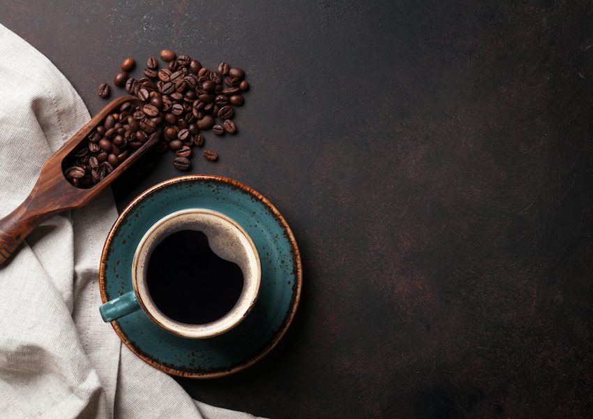 Overhead of a cup of coffee with coffee beans: wellbeing in older adults