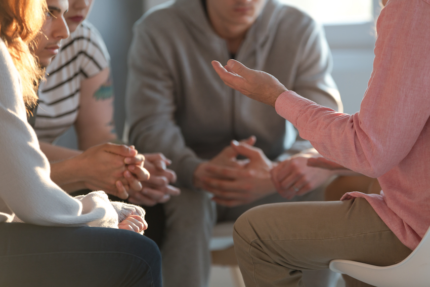 A circle of men and women in talking therapy